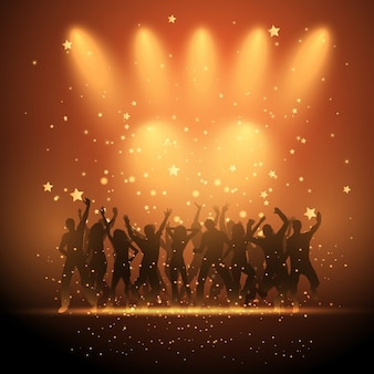 Siluetas de gente bailando en un fondo estrellado