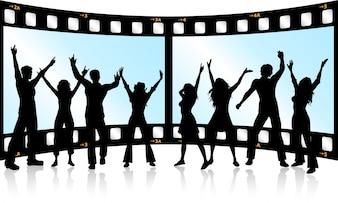 Siluetas de gente bailando sobre fondo de  tira de película