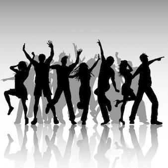 Siluetas de la gente del partido que bailan