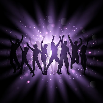 Siluetas de personas bailando sobre un fondo púrpura