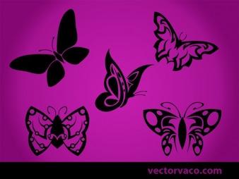 Siluetas hermosas mariposas tribales negros
