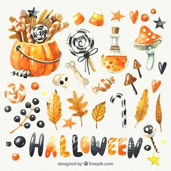 Surtido de caramelos y elementos de halloween de acuarela