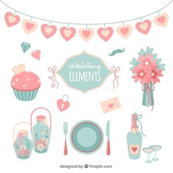Surtido de elementos de boda planos en colores pastel