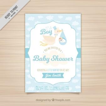 Tarjeta azul de bienvenida de bebé con una simpática cigüeña