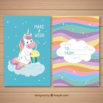 Tarjeta colorida con unicornio tierno y cupcake