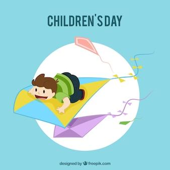 Tarjeta con un niño volando sobre una cometa