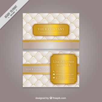 Tarjeta corporativa blanca con detalles dorados