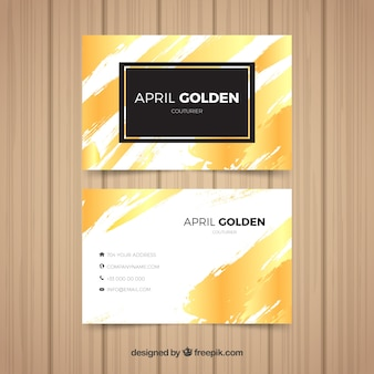 Tarjeta corporativa dorada con pinceladas