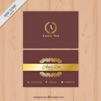Tarjeta corporativa elegante con ornamentos dorados