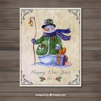 Tarjeta de acuarela de año nuevo con un muñeco de nieve