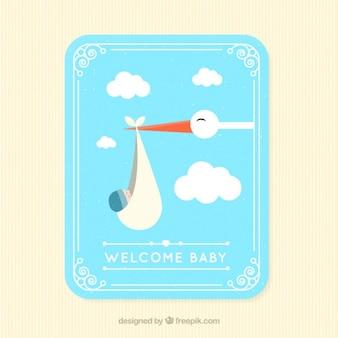 Tarjeta de adorable cigüeña volando con un bebé en diseño plano