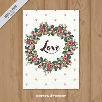 Tarjeta de amor de corona floral de acuarela con pequeños corazones