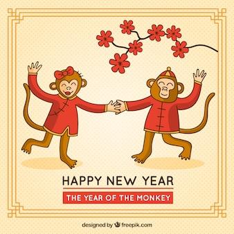 Tarjeta de año nuevo de monos bailando
