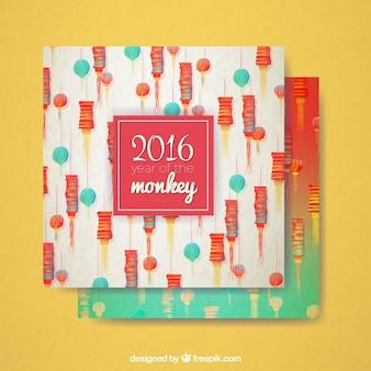 Tarjeta de año nuevo del mono de faroles pintados a mano