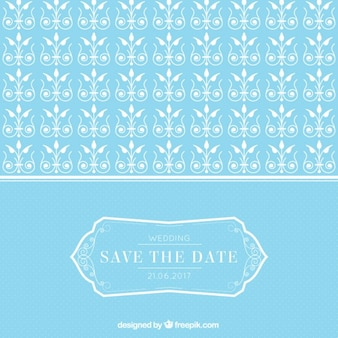 Tarjeta de boda azul con ornamentos