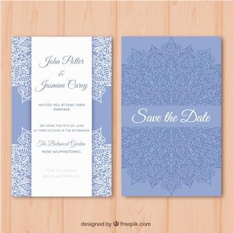 Tarjeta de boda azul y blanca con diseño de mandala