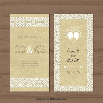 Tarjeta de boda ornamental con una pareja besándose
