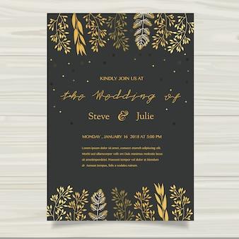 Tarjeta de boda oscura con elementos dorados