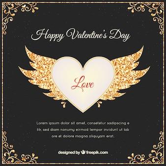 Tarjeta de corazón con alas de brillantina y detalles dorados