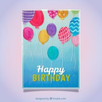 Tarjeta de cumpleaños con globos de acuarela