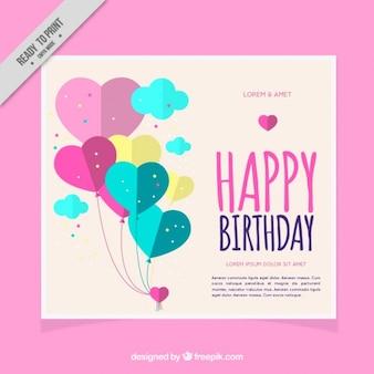 Tarjeta de cumpleaños con globos de corazones