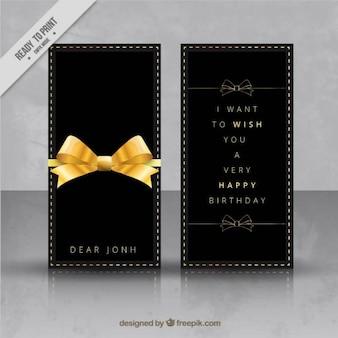 Tarjeta de cumpleaños con lazo dorado
