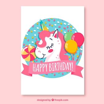 Tarjeta de cumpleaños con unicornio y globos