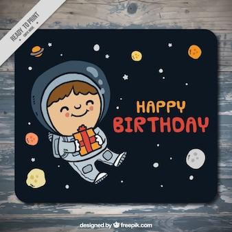 Tarjeta de cumpleaños de astronauta en el espacio dibujado a mano