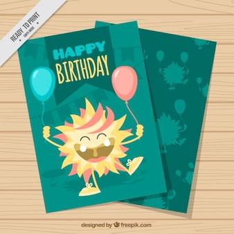 Tarjeta de cumpleaños de monstruo feliz con globos dibujado a mano