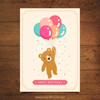 Tarjeta de cumpleaños de oso adorable con globos