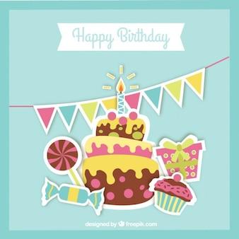 Tarjeta de deliciosa tarta de cumpleaños con dulces y regalo