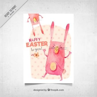 Tarjeta de felicitación de pascua con conejos de acuarela