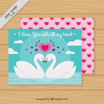 Tarjeta de felicitación del día de san valentín con cisnes románticos