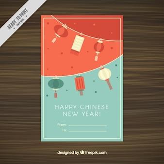 Tarjeta de feliz año nuevo chino con faroles decorativos colgando