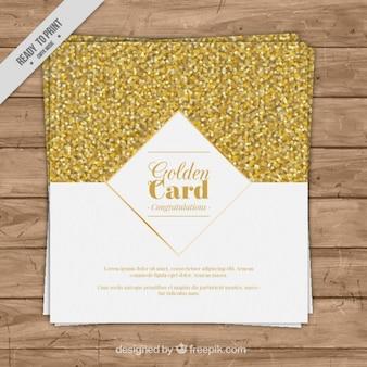 Tarjeta de lujo con confeti dorado