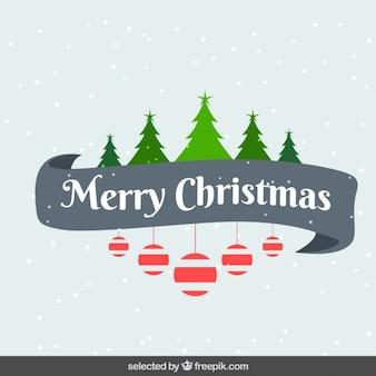 Tarjeta de Navidad colorida con árboles y adornos