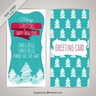 Tarjeta de navidad con árboles dibujados a mano