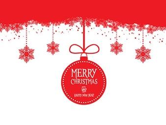 Tarjeta de Navidad con bola de navidad roja colgando