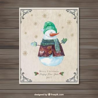 Tarjeta de Navidad con hombre de nieve en acuarela