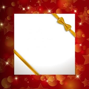 Tarjeta de navidad con lazo dorado
