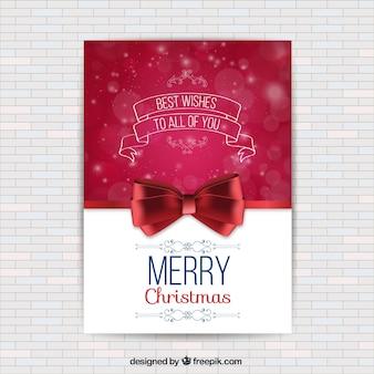 Tarjeta de navidad con un lazo rojo