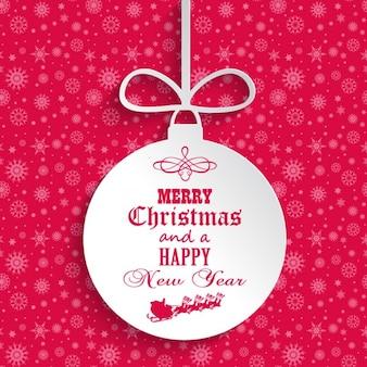 Tarjeta de navideña rosa con bola de navidad