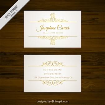 Tarjeta de negocios blanca con detalles dorados