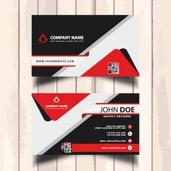 Tarjeta de negocios con elementos geométricos rojos