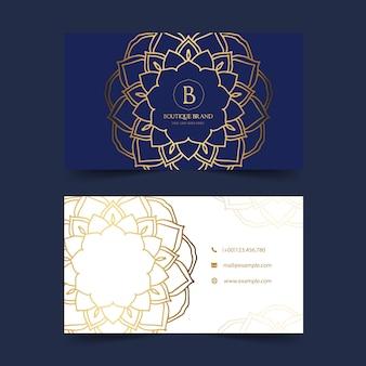 Tarjeta de presentación azul y dorada de boutique