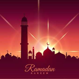 Tarjeta de ramadan kareem con mezquita y estrella brillosa