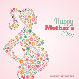Tarjeta de silueta floral de una mujer embarazada