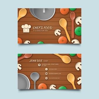 Tarjeta de visita con alimentos y fondo de madera