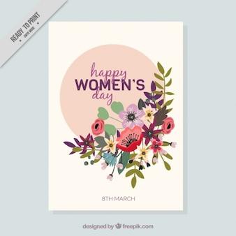 Tarjeta del día de la mujer con decoración floral en diseño plano