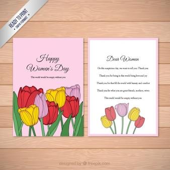 Tarjeta del día de las mujeres de tulipanes de colores